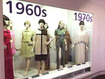 photograph of mannequins in display case wearing 1960s dresses